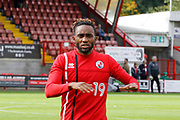 Crawley Town defender Cedric Evina (19) warms up before kick off during the EFL Sky Bet League 2 match between Crawley Town and Carlisle United at the Checkatrade.com Stadium, Crawley, England on 30 September 2017. Photo by Andy Walter.