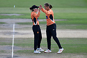 Fi Morris and Suzie Bates of Southern Vipers celebrate the wicket of Kirstie Gordon during the Kia Women's Cricket Super League semi-final match between Loughborough Lightning and Southern Vipers at the 1st Central County Ground, Hove, United Kingdom on 1 September 2019.