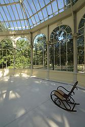 THEMENBILD - Madrid ist seit Jahrhunderten der geographische, politische und kulturelle Mittelpunkt Spaniens (siehe Kastilien) und der Sitz der spanischen Regierung. Hier residieren auch der König, ein katholischer Erzbischof sowie wichtige Verwaltungs- und Militärbehörden. Als Handels- und Finanzzentrum hat die Stadt nationale und internationale Bedeutung. Hier im Bild Schaukelstuhl im Kristallpalast, Palacio de Cristal, Glaspavillon von Ricardo Velazquez Bosco, Retiro-Park, Parque del Buen Retiro, Jardines del Buen Retiro // THEMATIC PACKAGES - Madrid is the capital and largest city of Spain. The population of the city is roughly 3.3 million and the entire population of the Madrid metropolitan area is calculated to be around 6.5 million. It is the third-largest city in the European Union, after London and Berlin, and its metropolitan area is the third-largest in the European Union after London and Paris. The city spans a total of 604.3 km2. EXPA Pictures © 2014, PhotoCredit: EXPA/ Eibner-Pressefoto/ Weber<br /> <br /> *****ATTENTION - OUT of GER*****