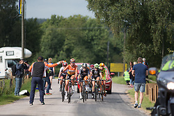 Chantal Blaak (NED) of Boels-Dolmans Cycling Team reaches for a fresh bottle from team soigneur during the 141 km road race of the UCI Women's World Tour's 2016 Crescent Vårgårda women's road cycling race on August 21, 2016 in Vårgårda, Sweden. (Photo by Balint Hamvas/Velofocus)