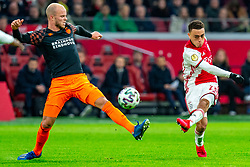 Sergino Dest #28 of Ajax, Jorrit Hendrix #8 of PSV Eindhoven in action during the match between Ajax and PSV at Johan Cruyff Arena on February 02, 2020 in Amsterdam, Netherlands