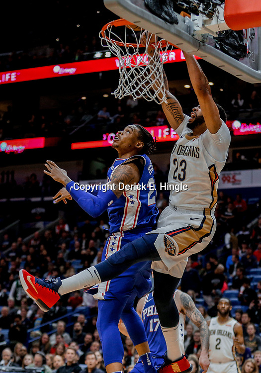 Dec 10, 2017; New Orleans, LA, USA; New Orleans Pelicans forward Anthony Davis (23) dunks over Philadelphia 76ers forward Richaun Holmes (22) during the second quarter of a game at the Smoothie King Center. Mandatory Credit: Derick E. Hingle-USA TODAY Sports
