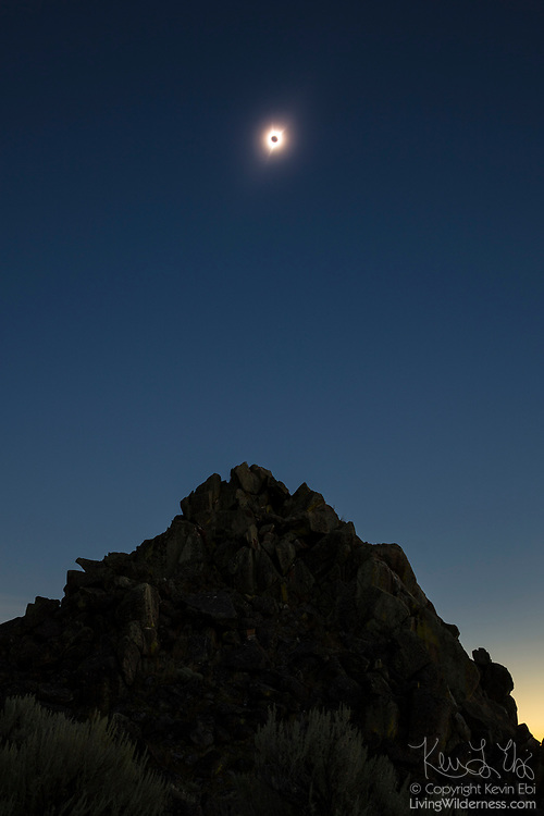 The solar corona shines bright over the pinnacle of a butte in the Mormon Basin of Malheur County, Oregon, during the total solar eclipse of August 21, 2017. The corona is an extremely hot plasma aura — as much as 450 times the temperature of the sun's surface — that extends millions of miles out from the solar disk that we typically see. The sun's surface is far brighter than the corona, usually outshining it. During a total solar eclipse when the moon blocks the view of the main body of the sun, the corona becomes visible.