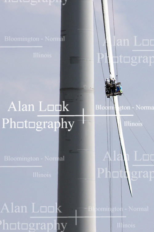 30 July 2012:  A basket with repairmen inside hangs along side the blades of a wind turbine at the White Oak Wind Farm in McLean County of Illinois