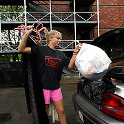 UNTIL NEXT YEAR --After finals,  a Drake University freshman loads her car for the trip home.  She'll be back next fall as a sophomore.  photo by david peterson