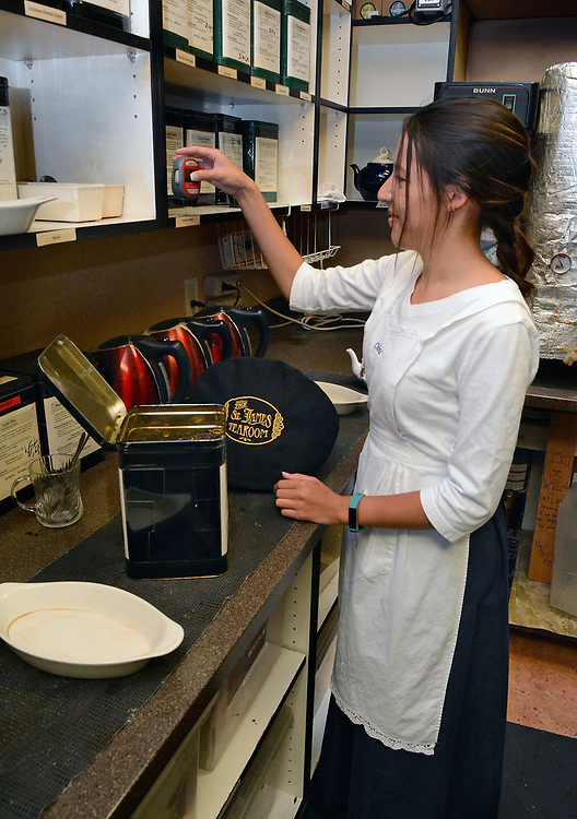jt050917g/biz/jim thompson/ China Stuckman sets the timer for the tea that she is brewing for a customer at the St. James Tearoom. Tuesday May. 09, 2017. (Jim Thompson/Albuquerque Journal)