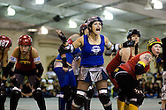 Isabelle Ringer shouts to the sidelines before the start of a bout.  The San Diego Derby Dolls were at the Del Mar Fairgrounds in Del Mar, California on November 08, 2008.  The all-female roller derby league, founded in 2005, features serious competition among skaters with tongue-in-cheek names such as Anita Battle and Isabelle Ringer.