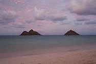 The full moon rises over the Mokes, two lava islands off the coast of Kailua, Hawaii.