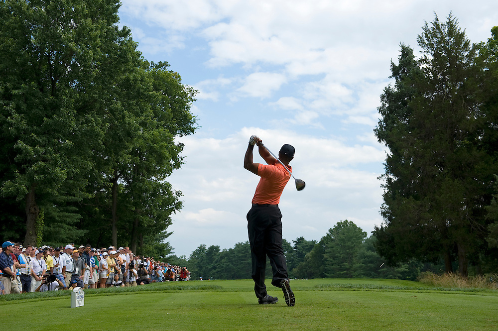 Tiger Woods of the US hits from the 16th tee during the first round of the AT&T National golf tournament at Congressional Country Club in Bethesda, Maryland at USA 02 July 2009.