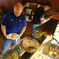 Eric Groves, of Southaven, goes through the buffet line at Southern Eatery during lunch on Tuesday.