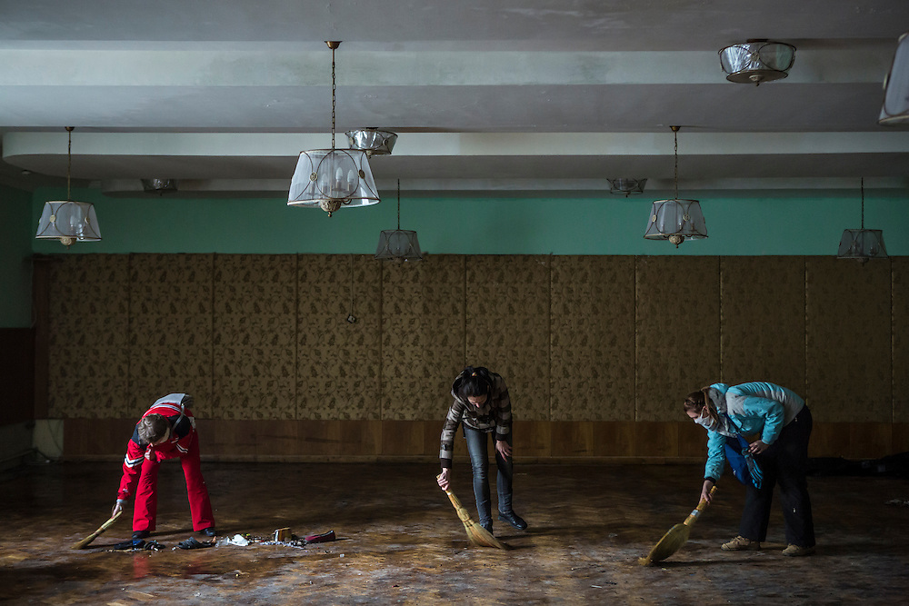 KIEV, UKRAINE - FEBRUARY 21: Women clean inside the partially burned Trade Unions Building, which has served as a de facto headquarters for anti-government protesters on Independence Square, on February 21, 2014 in Kiev, Ukraine. After a week that saw new levels of violence, with dozens killed, opposition and government representatives reached an agreement intended to resolve the crisis. (Photo by Brendan Hoffman/Getty Images) *** Local Caption ***