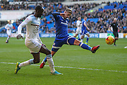 Albert Adomah of Aston Villa puts in a cross, under pressure from Joe Bennett of Cardiff City during the EFL Sky Bet Championship match between Cardiff City and Aston Villa at the Cardiff City Stadium, Cardiff, Wales on 2 January 2017. Photo by Andrew Lewis.