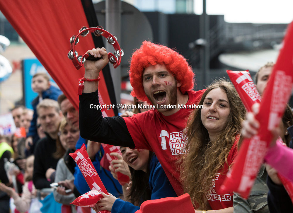 Charity members cheer on runners as they pass through Canary Wharf. The Virgin Money London Marathon, 23rd April 2017.<br /> <br /> Photo: David Levenson for Virgin Money London Marathon<br /> <br /> For further information: media@londonmarathonevents.co.uk