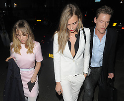 Suki Waterhouse and Cara Delevingne leaving the Karl Lagerfeld dinner at Harrods in London, UK. 13/03/2014<br />