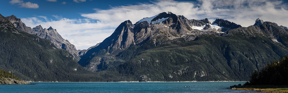 The mountains of the Kakuhan Range in the Tongass National Forest can be seen in the view from Mud Bay near Haines, Alaska on the Lynn Canal. EDITORS NOTE: Image is a panoramic composite of multiple overlapping images.