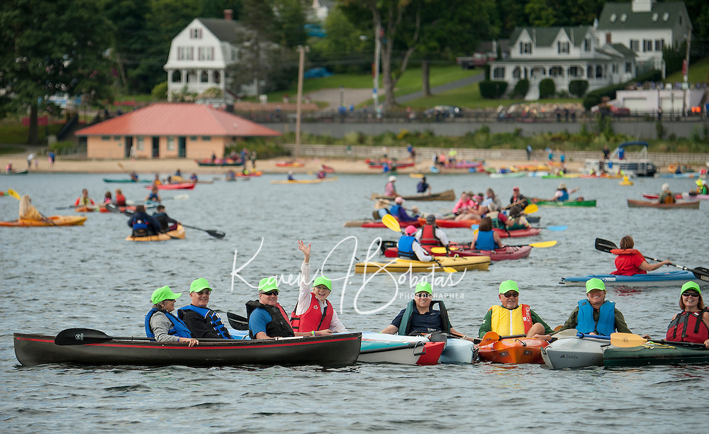 Lake Fest participants gather together prior to their attempt at the Guinness World Record on Saturday morning off Weirs Beach in Lake Winnipesaukee.  (Karen Bobotas/for the Laconia Daily Sun)
