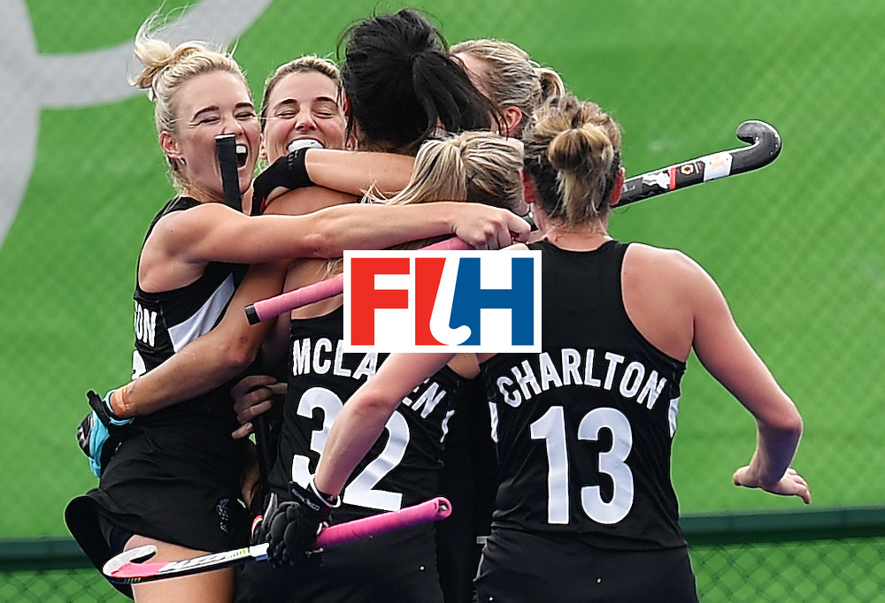 Netherlands' players celebrates after New Zealand's Kayla Whitelock (C) scored the equalizer during the womens's field hockey New Zealand vs Netherlands match of the Rio 2016 Olympics Games at the Olympic Hockey Centre in Rio de Janeiro on August, 12 2016. / AFP / Carl DE SOUZA        (Photo credit should read CARL DE SOUZA/AFP/Getty Images)