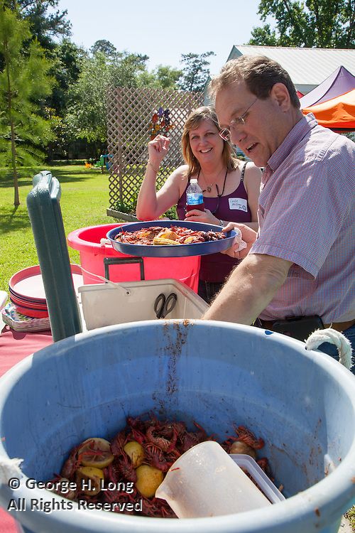 Leslie Blitch Welliver and JImmy Nelson at crawfish boil for the North Shore Chapter of Loyola University alumni at the home of George Long and Courtney Blitch in Abita Springs, Louisiana