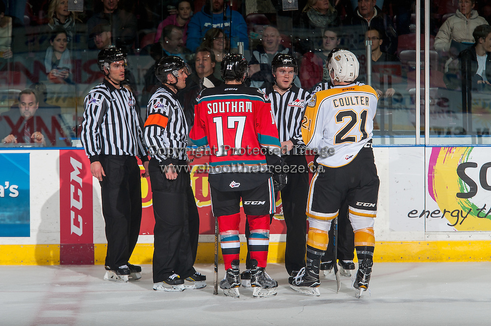 KELOWNA, CANADA - DECEMBER 3: Rodney Southam #17 of the Kelowna Rockets and Tyler Coulter #21 of the Brandon Wheat Kings stand with ice officials at the end of second period on December 3, 2016 at Prospera Place in Kelowna, British Columbia, Canada.  (Photo by Marissa Baecker/Shoot the Breeze)  *** Local Caption ***