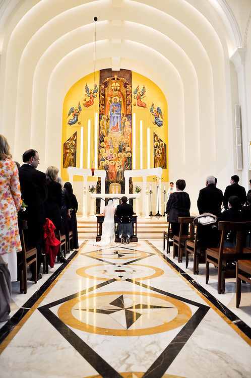 Kathleen & Brendan kneel before the altar, Madonna della Strada Chapel, Loyola University Chicago