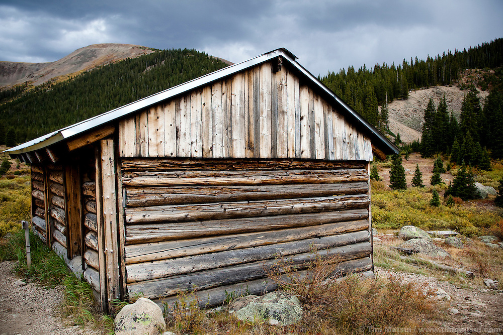 Ruin of a log cabin in a ghost town in the Rocky Mountains of Colorado.
