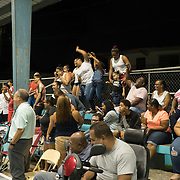 AUGUST 27, 2018--Cata&ntilde;o---PUERTO RICO--<br /> Residents enjoy the performance in the Andrade basketball court in the Pueblo Sector in Cata&ntilde;o where the play La Familia Perez takes place.<br /> (Photo by Angel Valentin/Freelance)