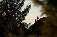 Two people hiking on Neahkahnie Mountain near Manzanita, Oregon.