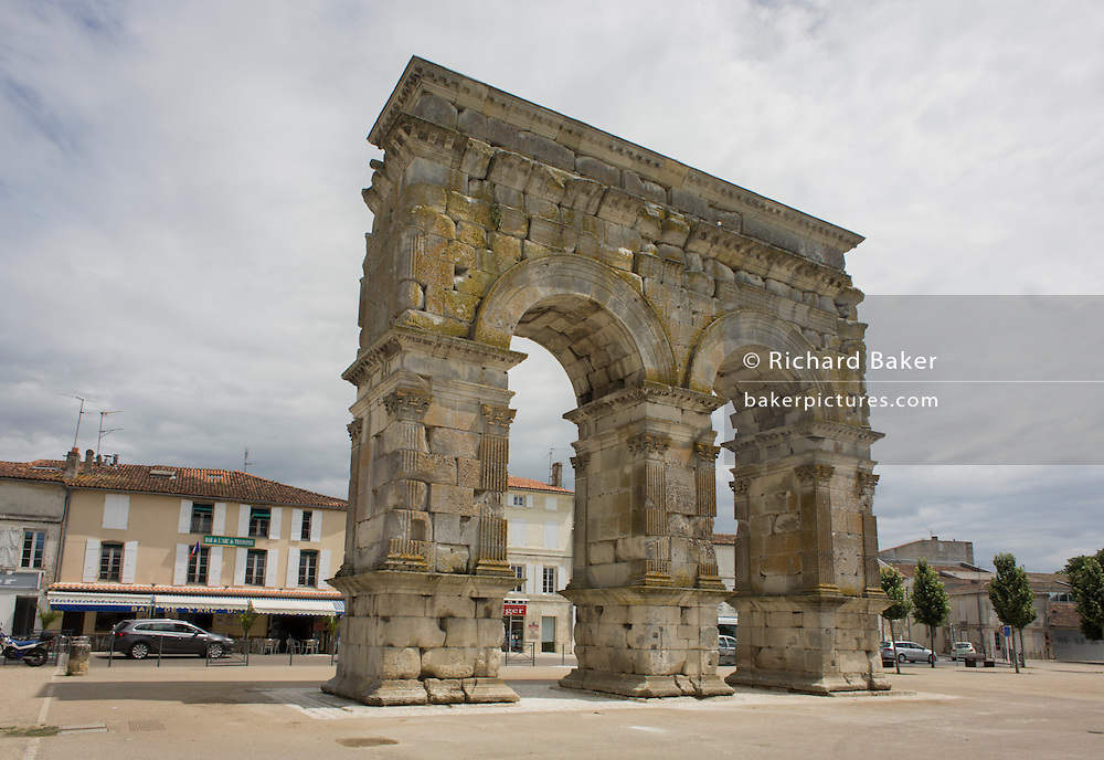 The Arch of Germanicus, an ancient Roman arch in Saintes, Charente-Maritime in France. It was built in 18 or 19AD by a rich citizen of the town (then known as Mediolanum Santonum), C. Julius Rufus, and dedicated to the emperor Tiberius, his son Drusus Julius Caesar, and his adoptive son Germanicus. It has two bays and was originally sited over the terminus of the Roman road from Lyon to Saintes. On the proposal of Prosper Mérimée in 1843 it was moved fifteen metres during works on quays along the river, and it was restored in 1851.