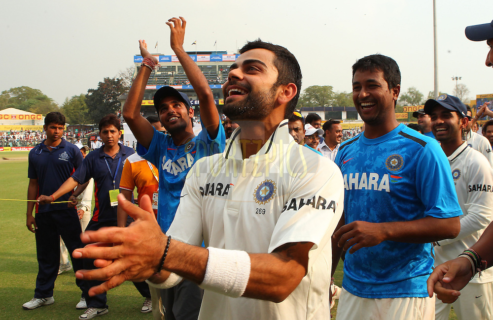 Virat Kohli of India celebrates the win during day 3 of the 4th Test Match between India and Australia held at the Feroz Shah Kotla stadium in Delhi on the 24th March 2013..Photo by Ron Gaunt/BCCI/SPORTZPICS ..Use of this image is subject to the terms and conditions as outlined by the BCCI. These terms can be found by following this link:..http://www.sportzpics.co.za/image/I0000SoRagM2cIEc