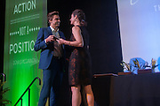 Dr. Krista McCallum-Beatty presents the Charles J. Ping International Student Leadership Award for an undergraduate to Andrew Black during The Leadership Awards Gala in Baker University Ballroom on April 1st.