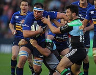George Lowe ( R ) of Harlequins challenges Dominic Ryan ( 2nd L ) of Leinster during the European Rugby Champions Cup match at Twickenham Stoop , London<br /> Picture by Paul Terry/Focus Images Ltd +44 7545 642257<br /> 07/12/2014