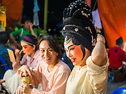 "26 NOVEMBER 2014 - BANGKOK, THAILAND: Performers put on their makeup before a Chinese opera performance at the Chow Su Kong Shrine in the Talat Noi neighborhood of Bangkok. Chinese opera was once very popular in Thailand, where it is called ""Ngiew."" It is usually performed in the Teochew language. Millions of Chinese emigrated to Thailand (then Siam) in the 18th and 19th centuries and brought their culture with them. Recently the popularity of ngiew has faded as people turn to performances of opera on DVD or movies. There are about 30 Chinese opera troupes left in Bangkok and its environs. They are especially busy during Chinese New Year and Chinese holidays when they travel from Chinese temple to Chinese temple performing on stages they put up in streets near the temple, sometimes sleeping on hammocks they sling under their stage.      PHOTO BY JACK KURTZ"