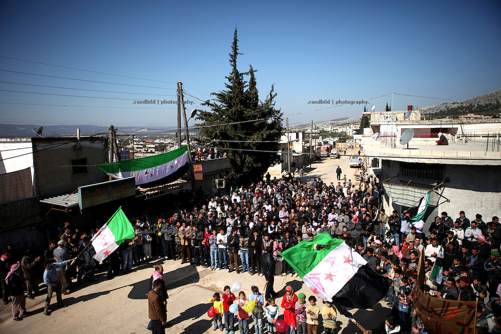 A demonstration with some 1.000 people after friday prayer in the Village of Al Kastan, Province of Idlib, Syria. Because of the strong opposition and Free Syrian Army the regular gathering can be hold without any attacks by the syrian Forces.
