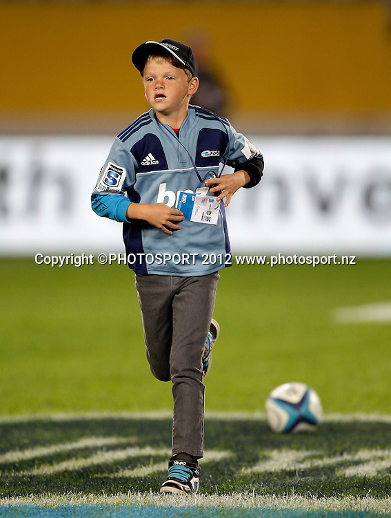 A young Blues fan runs the match ball on during the Super Rugby game between The Blues and The Sharks at Eden Park, Auckland New Zealand, Friday 13 April 2012. Photo: Simon Watts / photosport.co.nz