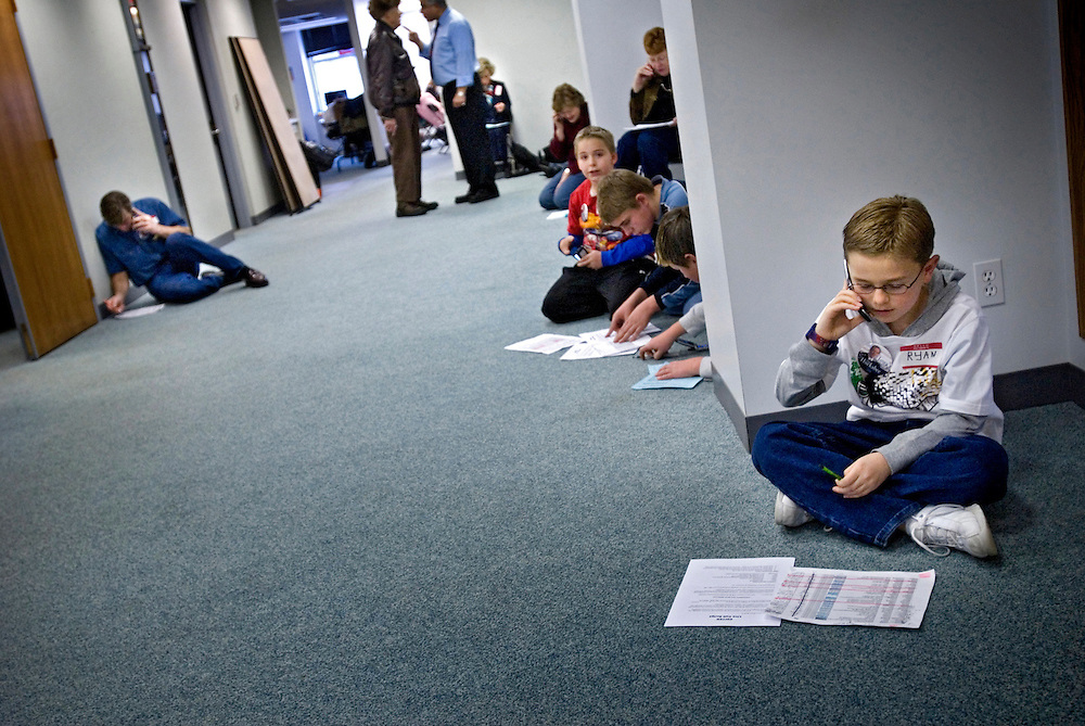 Iowa Primaries.Ryan Echols, 9, is part of a group of 21 adults and children, all home-schoolers, who drove from Flagstaff, Arizona to volunteer for Huckabee's Iowa campaign. The children, many of them grade school age, have been helping to staff republican candidate Mike Huckabee's daily phone bank operation...Here they are at the Huckabee campaign headquarters in downtown Des Moines, making last-minute phonecalls to potential voters to get them to caucus for Huckabee...Photo by Chris Maluszynski /MOMENT