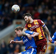 Romain Vincelot of Bradford City beats Gillingham forward Tom Eaves in the air during the EFL Sky Bet League 1 match between Bradford City and Gillingham at the Northern Commercials Stadium, Bradford, England on 24 March 2018. Picture by Paul Thompson.