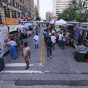 Spectator line up to buy food during the 27th DuPont Clifford Brown Jazz Festival Saturday, June 20, 2015, at Rodney Square in Wilmington, Delaware.