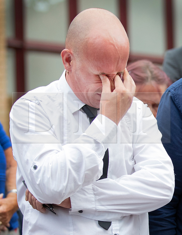 © Licensed to London News Pictures. 18/07/2018. Woking, UK. Private Sean Benton's twin brother Tony Benton struggles with his emotions as he and other family members leave Woking Coroner's Court after hearing the coroner's verdict that Sean died of self inflicted gunshot wounds to the chest. Pte Sean Benton was found with five gunshot wounds to his chest at Deepcut army base in 1995. Photo credit: Peter Macdiarmid/LNP