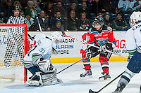 KELOWNA, CANADA - MARCH 18: Logan Flodell #31 of Seattle Thunderbirds makes a save on a shot from Nick Merkley #10 of Kelowna Rockets on March 18, 2015 at Prospera Place in Kelowna, British Columbia, Canada.  (Photo by Marissa Baecker/Shoot the Breeze)  *** Local Caption *** Logan Flodell; Nick Merkley;
