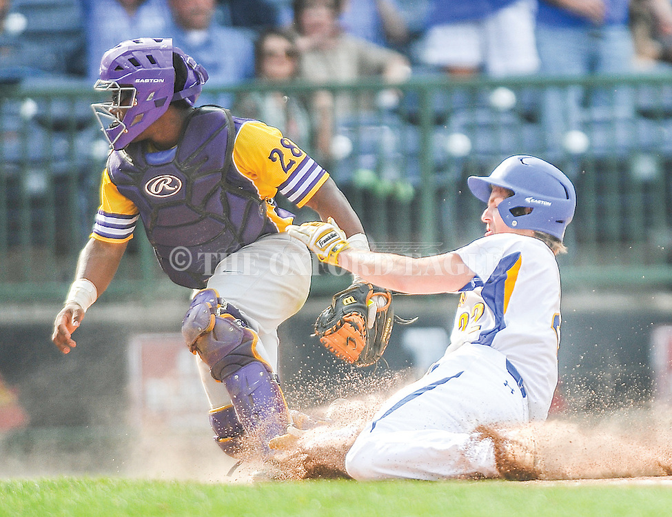 Oxford High's Preston Perkins (22) scores as the ball gets past Hattiesburg catcher Devin Lang (28) in the MHSAA Class 5A championship series at Trustmark Park in Pearl, Miss. on Thursday, May 19, 2016. Oxford won 10-0 to win its second straight state title.