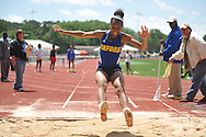 Oxford High's Janesha Johnson does the long jump in the MHSAA Class 5A North Half Track Meet in Oxford, Miss. on Saturday, May 4, 2013.