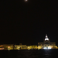 VENICE, ITALY - JUNE 15:  Final stages of the total Lunar eclipse are seen over the Giudecca Island on June 15, 2011 in Venice, Italy. The longest lunar eclipse for a decade took place tonight, a lunar eclipse comes when the sun, Earth and moon line up and Earth's shadow falls on the moon