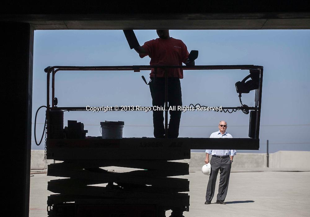 Michael Hackman, CEO of Hackman Capital Partners, at his construction site in Culver city. (Photo by Ringo Chiu/PHOTOFORMULA.com)