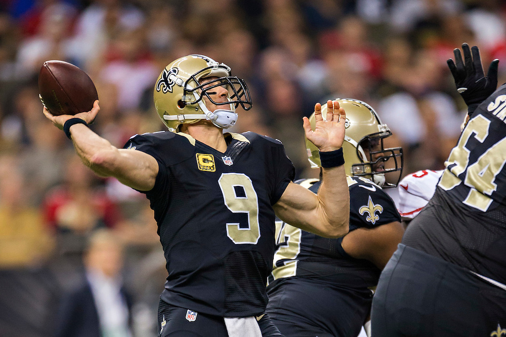 NEW ORLEANS, LA - NOVEMBER 9:  Drew Brees #9 of the New Orleans Saints throws a pass during the first quarter of a game against the San Francisco 49ers at Mercedes-Benz Superdome on November 9, 2014 in New Orleans, Louisiana.  (Photo by Wesley Hitt/Getty Images) *** Local Caption *** Drew Brees