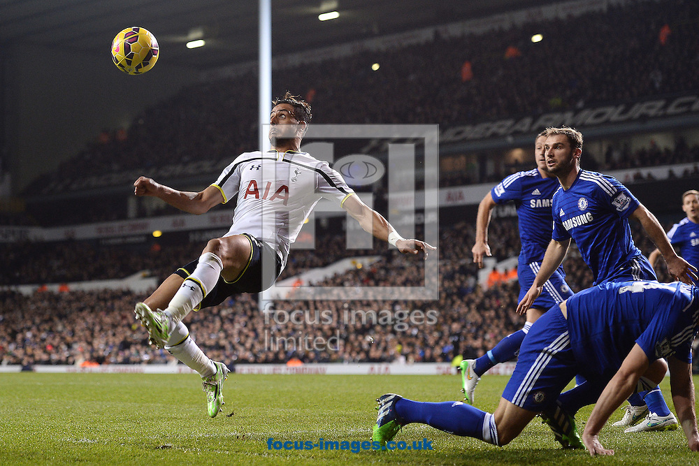 Nacer Chadli of Tottenham Hotspur tries an acrobatic effort at goal during the Barclays Premier League match between Tottenham Hotspur and Chelsea  at White Hart Lane, London<br /> Picture by Richard Blaxall/Focus Images Ltd +44 7853 364624<br /> 01/01/2015