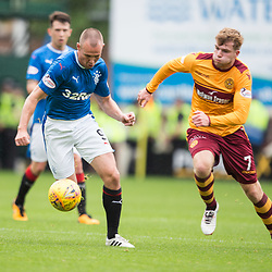 Kenny Miller of Rangers takes the ball past Chris Cadden of Motherwell, Motherwell v Rangers, Scottish Premiership, 6 August 2017 . (c) Adam Oliver | sportPix.org.uk