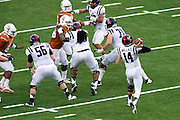 AUSTIN, TX - SEPTEMBER 14: Bo Wallace #14 of the Mississippi Rebels throws a pass against the Texas Longhorns on September 14, 2013 at Darrell K Royal-Texas Memorial Stadium in Austin, Texas.  (Photo by Cooper Neill/Getty Images) *** Local Caption *** Bo Wallace