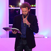 NLD/Amsterdam/20111122 - Presentatie sieradenlijn Cockring van Stacey Rookhuizen, schrijver Kluun, Raymond van der Klundert leest voor