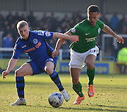 Jamie Allen guards the ball during the Sky Bet League 1 match between Rochdale and Scunthorpe United at Spotland, Rochdale, England on 21 March 2015. Photo by Mark Pollitt.