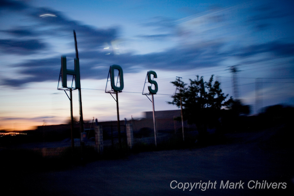 A Hostel sign against the dusk sky in central Spain.